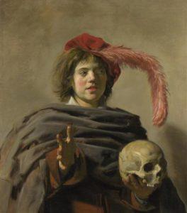 1428806001_young-man-holding-a-skull-vanitas.jpg